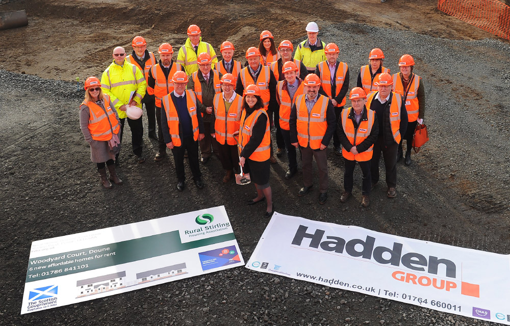 Councillor Evelyn Tweed (centre) is joined by (immediate left) RSHA Chairperson Margaret Vass and Bruce Crawford MSP along with representatives from Hadden Group, NHS Forth Valley, Stirling Council, Kilmadock Community Council and Glenn Murray Associates as she breaks the ground at the Balkerach Street development in Doune